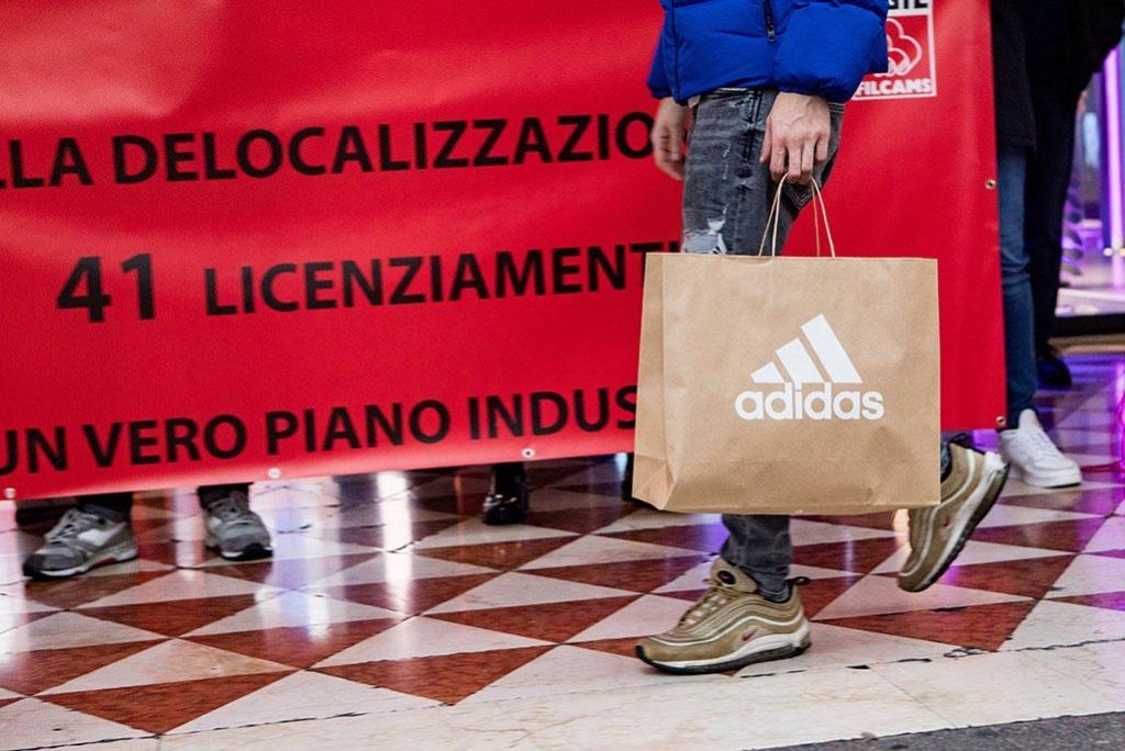 Adidas阿迪达斯欧洲裁减500职位 意大利员工专卖店前抗议 Clarks其乐重组计划遣散170员工